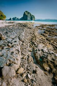 Rocky coastline leading line to gorgeous Pinagbuyutan island in background. Dreamlike landscape scenery in El Nido, Palawan, Philippines