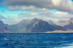 Rocky Lofoten islands sea shore with dramatic sky. Sea view, Norway