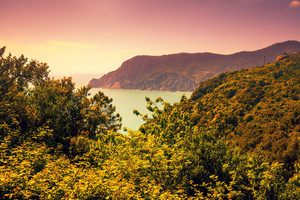 Rocky sea coast at sunset. Ligurian sea, Monterossa Village, Cinqe Terre, Italy