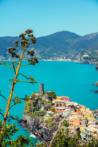 Rocky sea coast. Ligurian sea, view at Vernazza Village, Cinqe Terre, Italy