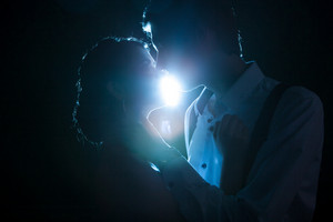Romantic couple backlit with a blue light from behind. Studio photo