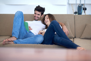 romantic relaxed young couple at modern home using tablet computer