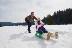 romantic winter  scene, happy young couple having fun on fresh show on winter vacatio, mountain nature landscape