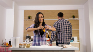 Romantic young couple cooking together in the kitchen. Having a great time together