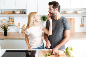 Romantic young couple preparing dinner in the kitchen at home
