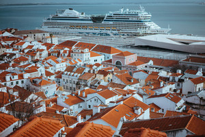 Rooftopspanorama of the oldest district Alfama in Lisbon. Cruise boat on the Tagus River. Lisbon Lisboa Lissabon