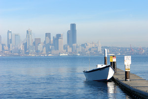 Row Boat with the city of Seattle in the background