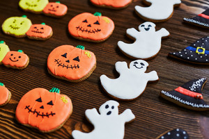 Rows of Halloween biscuits on wooden background
