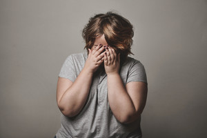 sad plus size woman is crying