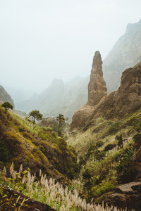 Santo Antao. Cape verde. Xo-Xo valley with amazin mountain peaks. Many cultivated plants growing in the valley between high rocks. Arid and erosion ground covered by dust air