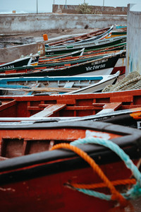 SANTO ANTAO ISLAND, CAPE VERDE - December 23, 2017: Colored local fishing boats along the old fishing shore. Ponta do Sol Santo Antao Cape Verde