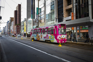 sapporo hokkaido japan - october8,2018 : street car tram approaching to station in sapporo city hokkaido island northern japan