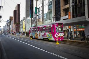 sapporo hokkaido japan - october8,2018 : street car tram approaching to station in sapporo city hokkaido island northern japan