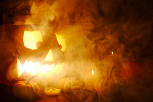 Scary jack-o-lantern and Halloween lights in mist