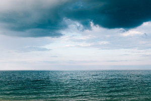 Sea and storm clouds, minimalistic landscape