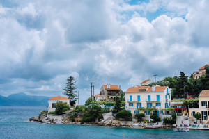 Seascape mit moved clouds over Fiskardo village on Kefalonia Island Greece