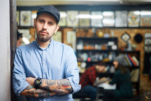 Self-employed tattoo master in his salon