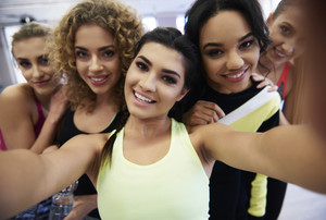 Selfie of five fit and attractive young women