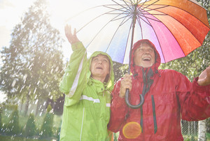 Senior couple playing with rain