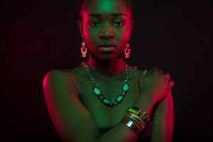 Sensuous Woman Wearing Jewelry Over Black Background
