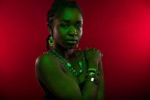 Sensuous Woman Wearing Jewelry Over Red Background
