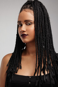 serious black woman with braids