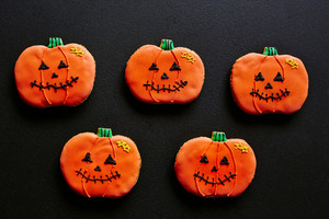 Several cookies in form of pumpkins