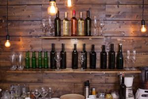 Shelves in a pub full of different wine bottles. Vintage pub.