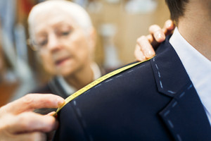 Shoulder of businessman in jacket visiting tailor