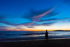 Silhouette Female Standing At Beach During Sunset