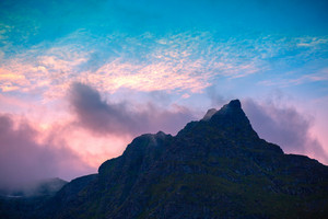 Silhouette of the mountain peak against the sky in the evening.