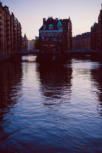 Silhouette of water castle in old Speicherstadt or Warehouse district in evening sun light, Hamburg, Germany