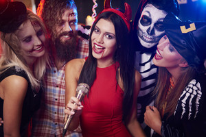 Singing karaoke at halloween party