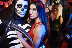Skeleton posing with his evil girlfriend