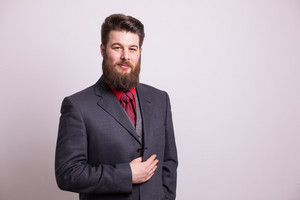 Smiling bearded man with suit jacket over white background. Confident man. Formal