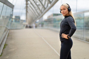 Smiling Woman in Black Workout Outfit Listen To Music on Headphones