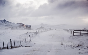 Snow storm attacks a rural road