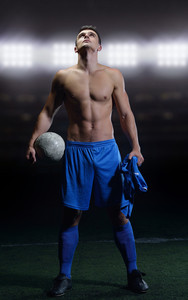 soccer player doing kick with ball on football stadium