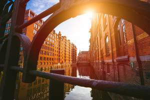 Speicherstadt Hamburg. Famous landmark of old buildings made with red bricks. Bridge and sun rays in low angle view