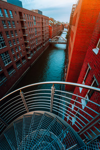 Spiral staircases in the old Warehouse District from canal side with red brick buildings of Speicherstadt in Hamburg. Blue hour