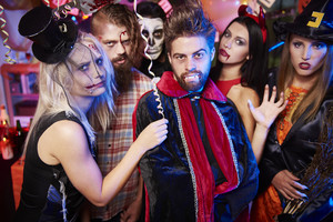 Spooky costumes of halloween party participants
