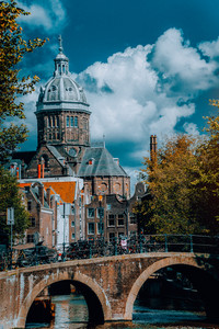 St. Nicholas Church in Amsterdam against white clouds at autumn sunny day. Amazing vibrant scenery Holland, Netherland