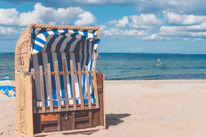Stripe blue colourfed beach roofed chairs in Travemunde, Germany
