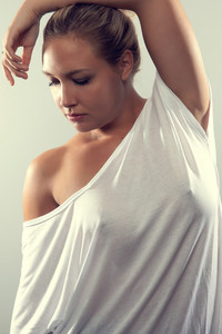 Studio portrait of beautiful woman with blonde hair and white t-shirt