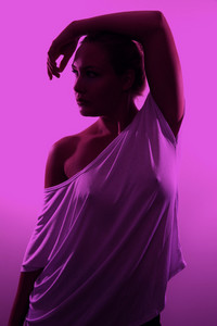 Studio portrait of gorgeous woman posing in pink light