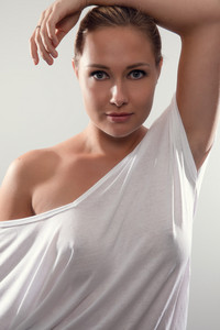 Studio portrait of gorgeous woman with blonde hair and white t-shirt