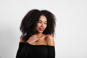 studio shoot of black woman with big afro hair