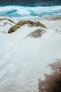 Stunning desolate landscape of sand dunes, ocean waves on Baia Das Gatas. North of Calhau, Sao Vicente Island Cape Verde