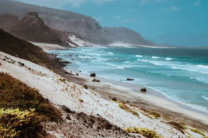Stunning view over barren rugged volcanic cliffs and sand dunes. Vast plain of the coastline. Baia Das Gatas. North of Calhau, Sao Vicente Island Cape Verde