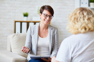 Successful psychologist talking to her patient